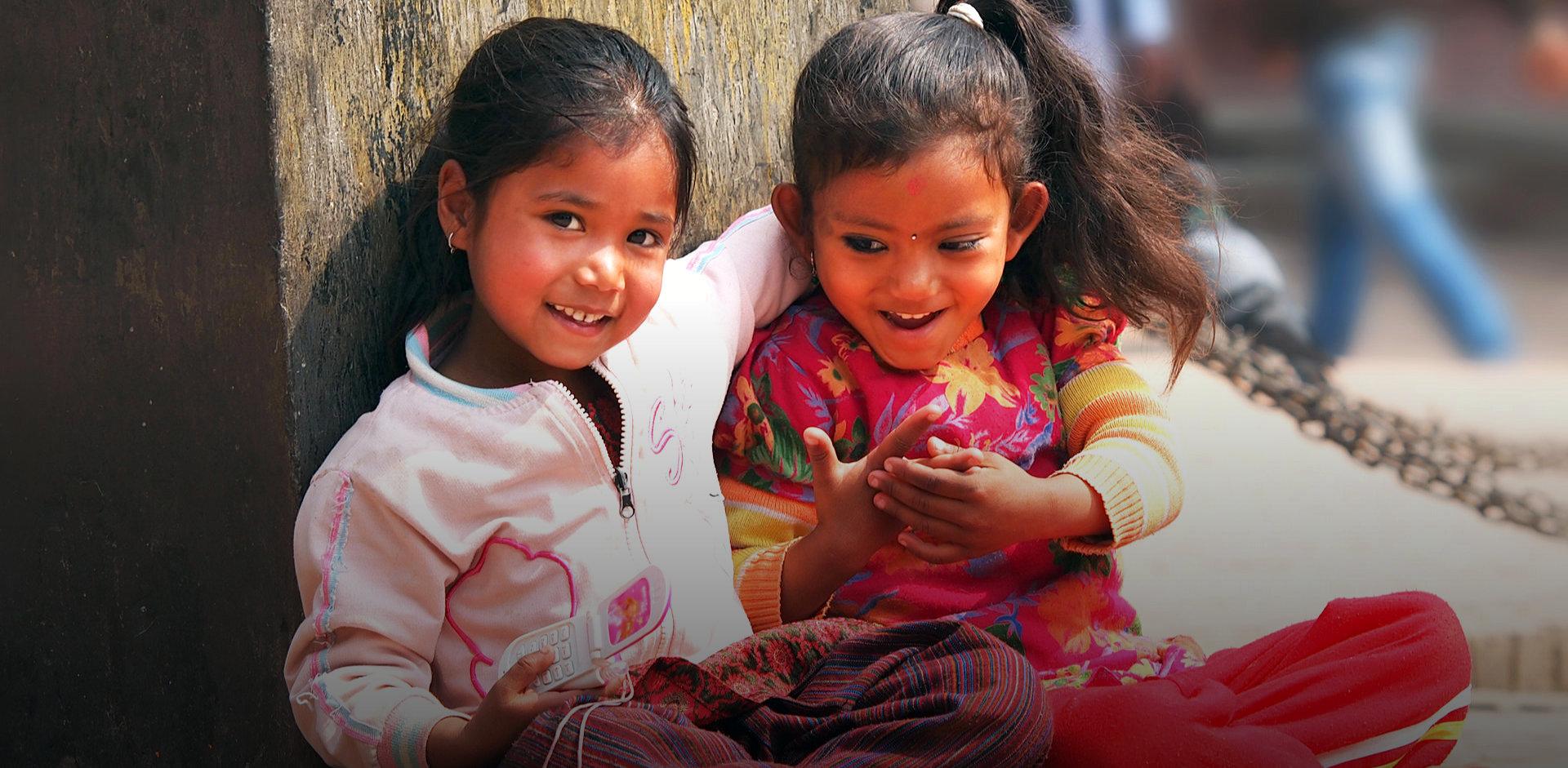 two lovely little girls smiling