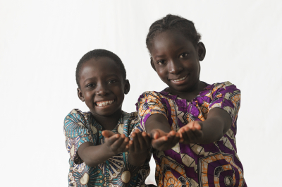 two african children showing their palms begging for some